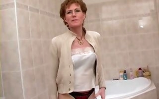 Granny shows off in full nudity scenes down the shower