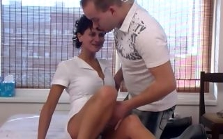 Short haired mature tries a bit of cock in her ass